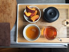 Morning routine. A golden tip Yunnan Chinese black tea and a peach. (mpieracci) Tags: bamboo tray peach black yunnan chinese tea