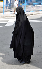 Muslim woman wearing abaya and niqab, Park Extension, Montreal (Blake Gumprecht) Tags: woman black quebec robe montreal muslim islam hijab immigrants niqab abaya immigration minorities multiculturalism ethnicdiversity khimar parkextension