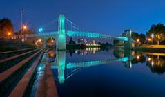 Suspended in blue...Explored (Captain Nikon) Tags: nottingham bridge framed bluehour suspensionbridge starburst rivertrent reflectons nikond90 wilfordsuspensionbridge flickrandroidapp:filter=none