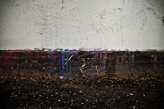 Graffiti abatement (Wespennest) Tags: pink blue red white colors alexandria wall graffiti virginia paint dirt mauve ceruleanblue holmesrun