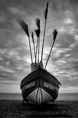 SM692 (Craigraymond82) Tags: sea england blackandwhite storm beach clouds sussex coast worthing shingle pebbles filter nets fishingboat weldingglass weldersglass