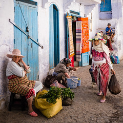 Chefchaouen  - Street (aminefassi) Tags: world life africa street old city travel blue portrait people copyright color colour square lumix women market candid traditional arabic panasonic morocco maroc getty souk medina chaouen pancake chefchaouen chefchauen marokko dmc moroccan 2012 rif carr  photographe minth chauen m43 mft marocain xauen morokko  marueccos gx1 chefchaouene flickr10 aminefassi xexauen