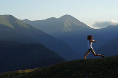 Running in the Tushetian Mountains, Georgia (Simon Christiaanse) Tags: sunset woman sun mountains nature girl georgia landscape legs running caucasus shorts sakartvelo tusheti  omalo   simonchristiaanse