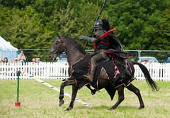 Black Knight (Chris Turner Photography) Tags: show horse devils horsemen medieval arena entertainment riding lance knight armour reenactment horseback jousting reenactor charging 2012 attacking chertsey quintain