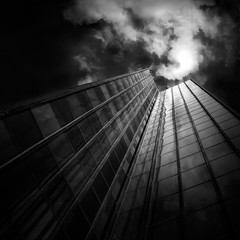 mystical (Julia-Anna Gospodarou) Tags: city sky urban blackandwhite bw building tower monochrome architecture modern clouds dark square nikon tripod perspective dramatic athens greece le highrise mystical tall polarizer tamron highlight contrasts 2012 upwards manfrotto modernbuilding hoya curtainwall glasswall blacksky nd400 manfrotto055xprob bw106 nikond7000 juliaannagospodarou siruik20x tamronaf1