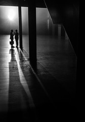 The Conversation (Rupert Vandervell) Tags: people mist streets london night dark shadows dramatic nightime late conversation pillars tension stphotographia