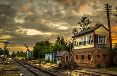 Sunset Signal Box. (ian.emerson36 (off for a week, going camping)) Tags: signalbox semaphore railway heritage sunset warm clouds buildings clutter lightroom adobe canon 1855mm trees hut