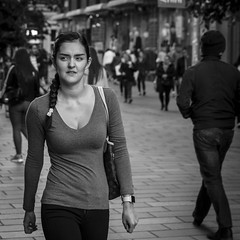 Look Right (Leanne Boulton) Tags: life street city uk light shadow portrait people urban blackandwhite bw woman white black detail texture girl monochrome beauty face look female canon square 50mm mono scotland living blackwhite pretty natural emotion humanity outdoor expression glasgow candid young culture streetphotography streetlife scene depthoffield human shade crop 7d figure format society tone facial braid plait candidstreetphotography