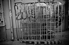 In a Prison of My Own Making? (stimpsonjake) Tags: nikoncoolpixa 185mm streetphotography bucharest romania city candid blackandwhite bw monochrome break work prison carts cigarette coffee
