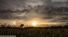 SUN DOGS PARHELIA ST DAVIDS (RHYSDYFED) Tags: sundogs sundog parhelia canoneos760dcloudsweathersunsetpembrokeshirecampingepicvisit walessir benfrocanoneos760d canon tokina 1116mm