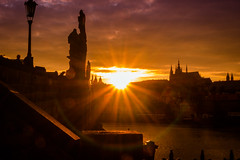 Prague - Charles Bridge against the sun (raha79) Tags: city bridge light sun against golden evening prague sony low prag charles praha most karlv nex5 sel1855