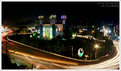 Colors of Azadi (hellosheraz) Tags: road pakistan light red motion cars monument beautiful night garden lights star long exposure traffic flag tripod trails headlights lahore minarets azadi chauburji backlights 14august minars chouburji