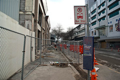 The Right Building is Down Now! (Jocey K) Tags: road street city trees newzealand christchurch sky signs cars architecture fence buildings demolition cranes nz cbd digger deconstruction roadcones earthquakedamage