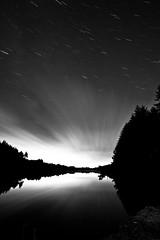 Apple wood (Nick JH) Tags: longexposure trees light sky blackandwhite reflection water stars glow yorkshire reservoir startrails slowshutterspeed lightstreaks codbeck canon1740mml canoneos5dmkii