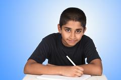 Homework (Arvind ( www.dreamexposures.com )) Tags: school boy test green home childhood smiling horizontal modern youth pen writi
