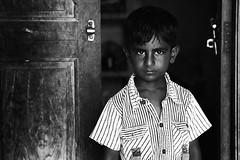 UNWANTED Visitor !!! (bmahesh) Tags: street door boy portrait people blackandwhite india canon village expression streetportrait expressive canon5d chennai mahesh tamilnadu ruralindia canonef24105mmf4isusm chengalpet canoneos5dmarkii bmahesh chettipuniyam