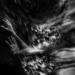 trapped in form (Vasilis Amir) Tags: longexposure boy portrait blackandwhite motion blur male monochrome leaves river square moving hands experimental move transparency cave transparent slowspeed  abstractportrait mygearandme vasilisamir