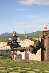 Baranta - in flight 2 (Romeodesign) Tags: old woman castle fall wall fight jump hungary action spears air traditional flight attack medieval freeze historical fighters spear solymar 550d baranta