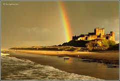 Somewhere Under A Rainbow! (dave091260) Tags: sunset castle beach canon reflections dawn rainbow colours northumberland bamburgh bamburghcastle abigfave canoneos500d canonrebelt1i dave091260 davecappleman davecapplemanphotography