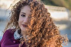 Curly hair golden hour (LuxTDG) Tags: ritratto portrait sorriso smile see occhi eyes giovane ragazza young lady girl capelli ricci rossi mossi red bambola doll spiaggia beach freddo cold tramonto sunset ora dorata mare sea cielo sky nuvole clouds wind torregaveta campania italy italia