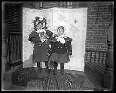 Girls on a porch with a kitten - glass negative #2 (sctatepdx) Tags: victorian victorianchildren victorianclothes victoriancoat victorianbonnet kitty kitten cat decorativescreen victorianscreen glassnegative buttonupshoes tabbycat tabbykitten