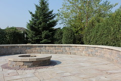 raised firepit with surrounding seat walls (bretmarlandscape) Tags: brick landscape backyard landscaping patio entertainment seating pillars firepit landscaper landscapedesign seatwall landscapearchitect unilock bretmarlandscape