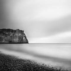 Time goes by (Ludovic Cadet Photo) Tags: longexposure sea blackandwhite bw mer seascape canon landscape noiretblanc shoreline nb cliffs 7d paysage etretat falaises galet littoral sigma1020 poselongue nd110