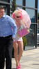 Angelyne Tries to get shade under her pink parasol whilst shopping Malibu, California