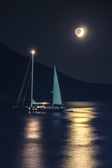Moonlight over the sailboat (Vagelis Pikoulas) Tags: blue light sea summer moon mountain mountains west colour reflection beach night sailboat canon landscape eos boat kiss europe niceshot view greece porto western sail x4 2012 attiki germeno 550d abigfave colorphotoaward mygearandme ringexcellence dblringexcellence musictomyeyeslevel1 eltringexcellence