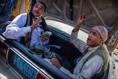 two men selling qat (a plant drug with the principles LSD) inside the rear hood of a car market of qat, old Sana'a,Yemen (anthony pappone photography) Tags: world pictures travel people digital canon lens photography photo republic foto image market picture culture unesco arabia drug yemen fotografia sanaa ramadan droga reportage photograher sejima suk arabo yemeni phototravel yaman    arabie arabiafelix  arabianpeninsula           alyaman yemenpicture yemenpictures eos5dmarkii