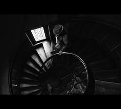 Dimly lit staircase (EddyB) Tags: eddyb fuji fujinon xt1 xf1855f284mm europa europe francia france chateaudazaylerideau chateau castillo castle escaleras stairs downstairs blackandwhite blackwhite bw factorhumano humanfactor penumbra shadows escaleradecaracol spiralstaircase
