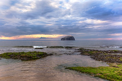 Bass Rock from Seacliff Beach (MilesGrayPhotography (AnimalsBeforeHumans)) Tags: britain beach seacliffbeach canon eos 6d canon6d dusk ef europe evening eastlothian castle 1635 canonef1635mmf4lisusm f4l firthofforth historic iconic uk landscape lothians nighfall outdoors ocean photography bassrock rocks scotland sunset sky seascape tantalloncastle waterscape wide