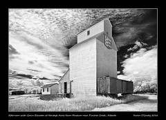 Afternoon with Grain Elevator at Heritage Acres Farm Museum near Pincher Creek, Alberta (kgogrady) Tags: afternoon grainelevator heritageacresfarmmuseum infrared landscape summer pinchercreek alberta canada blackandwhite canadianprairies buildings canadianlandscapes blackwhite cans2s 2016 bw albertalandscapes ab clouds elevator farming heritage fujinon fujifilmxpro1 fujifilm picturesofgrainelevators nopeople prairie southernalberta trees photosofgrainelevators noone rural westerncanada xf14mmf28r xpro1 weathered wooden