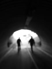 Silhouettes..... (tvedepigen) Tags: street silhouette walking people men light tunnel shady shadow blurred blurry blur blackwhite white black