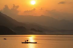 Golden Sunset (craigkass) Tags: nepal sunset lake mountains fishing asia pokhara