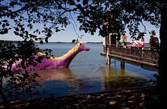 Edward the Booble (ZeiR) Tags: bridge trees sea people beach canon pier shadows dragon purple sigma foliage moomin muumi naantali bathhouse moominworld muumimaailma edwardthebooble uimahuone dronttiedvard