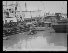"Pulling up sunken tug ""Eileen Ross"" at T-Wharf (Boston Public Library) Tags: maritime tugboat towboat pierswharves lesliejones twharf marineaccidents rosstowboat eileenross"