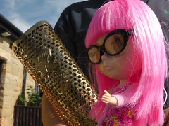 Ham tries to nick off with an Olympic torch.