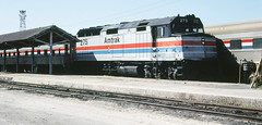 Amtrak Silver Star is led by EMD F40PHR locomotive # 275, and is soon to depart northbound from Tampa Union Station while on-going track construction work continues at Tampa, Florida, February 1984 (alcomike43) Tags: old railroad color classic vintage ties photo diesel platform tracks engine slide trains historic 106 amtrak photograph rails depot locomotive sleeper ballast 275 rightofway scl dieselengine tampaflorida seaboardcoastline emd 2681 passengertrains roadbed diesellocomotive dieselelectriclocomotive f40phr tampaunionstation heritagecars platformcanopy amtraksilverstar conventionaljointedsectionrail