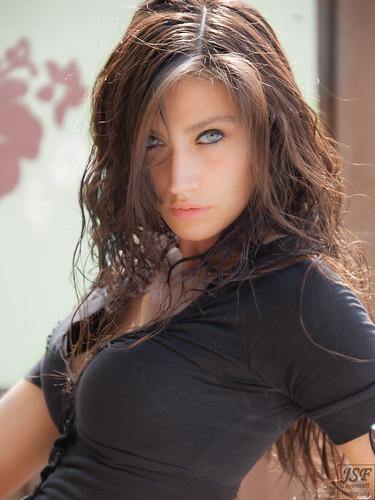 Busty blue eyed brunette