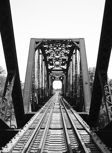 through truss railroad train railway steel iron bridge bastrop texas colorado river black white blackandwhite bw monochrome blackwhite pontist united states north america