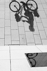 drop shadow (.martinjakab) Tags: bike bicycle blackandwhite schwarzweiss shadow monochrome x100t fujifilm mirror fahrrad pattern pavement