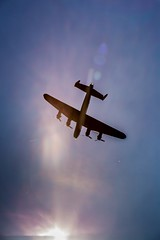 Lancaster into the Sun (deltic17) Tags: sunlight history canon fire remember bright rollsroyce merlin flare lancaster ww2 bomber raf avro lestweforget battleofbritain avrolancaster lancasterbomber bbmf intosun bombercommand rafconingsby bombercounty canon5dmk3 5dmk3