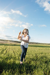 Running around outside with a paper plane (Robert Lang Photography) Tags: bluesky cereal cloud female fun grass green joy oneperson paperplane plane play run running sunflare sunshine toy vertical wheat youth outside