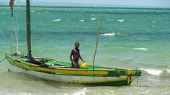 Boy Bailing Out Dhow Sailboat, Vilanculos, Mozambique (dannymfoster) Tags: africa mozambique vilanculos indianocean beach people africanpeople child boy dhow