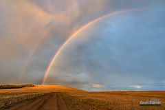 Hunt Mountain Rainbow (kevin-palmer) Tags: huntmountain bighornmountains bighornnationalforest august summer nikond750 evening sunset rainbow double dirt road clouds weather storm orange sunlight color colorful tamron2470mmf28