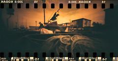 In rete (pinhole redscale) (danielesandri) Tags: trieste muggia traghetto marte forostenopeico film friuliveneziagiulia kodak redscale tina135 pellicola pinhole mare adriatico