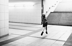 Billy Elliot (marcin baran) Tags: boy kid child children run running jump jumping tunnel stairs station corridor wallls lights street moment streetphotography move movement fly flying candid candidphotography streetphoto bw black blackwhite mono monochrome gliwice poland polska fuji fujifilm x100 x100t city urban people alone one composition