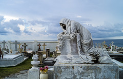 Cementery in Old San Juan, PR. (E S M Photography) Tags: summer blue sky clouds sunday crypt cementery sanjuan historic statue caribbean cross rest rip flowers sea creapy old time