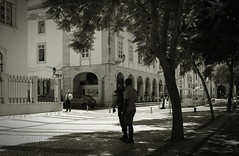 sorry officer (frucht-drops) Tags: portugal cop people streetview bandicoot blackandwhite faro police officer polizist polizei talking gesprch outdoor drausem bume trees lichtundschatten shadows